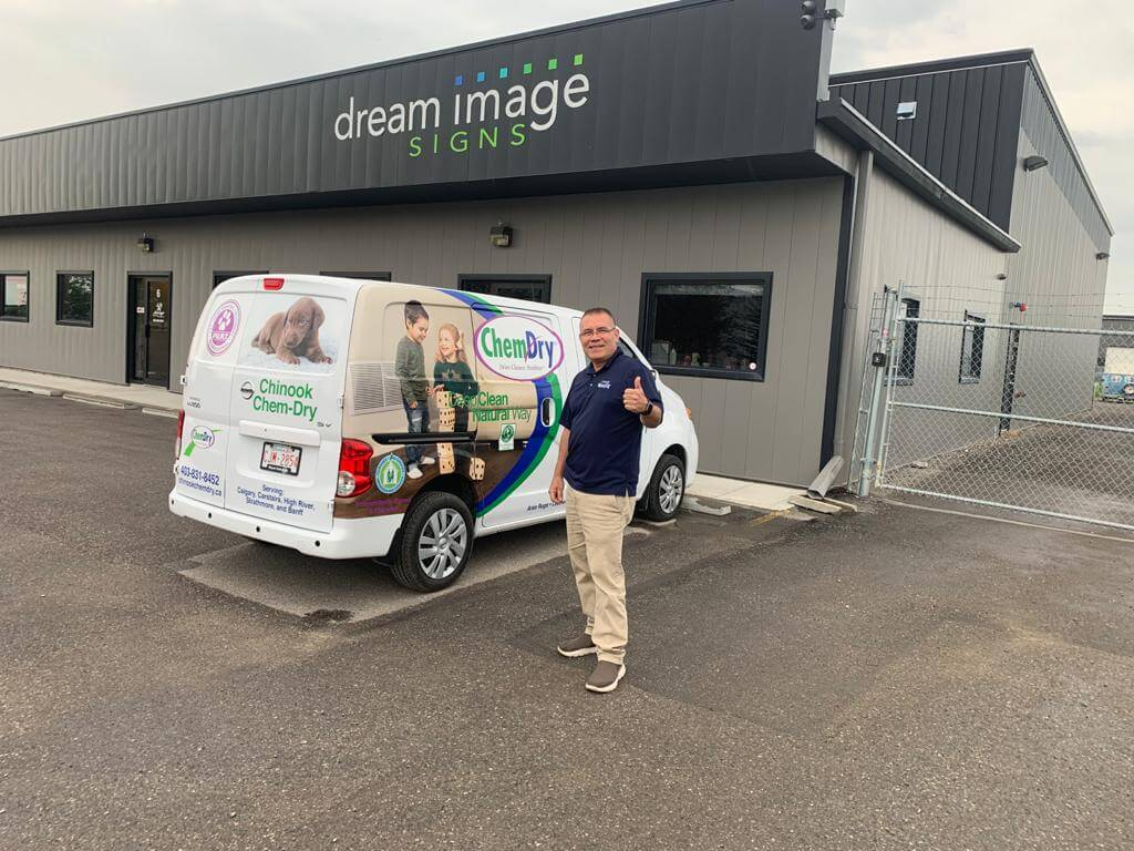 Hugo Perez, Chinook Chem-Dry owner, standing in front of a new van